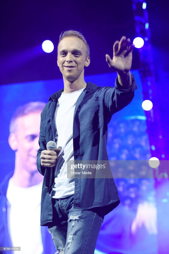 German singer Sandro Malinowski performs during 'Die Schlagernacht des Jahres' at Lanxess Arena on April 29, 2017 in Cologne, Germany.