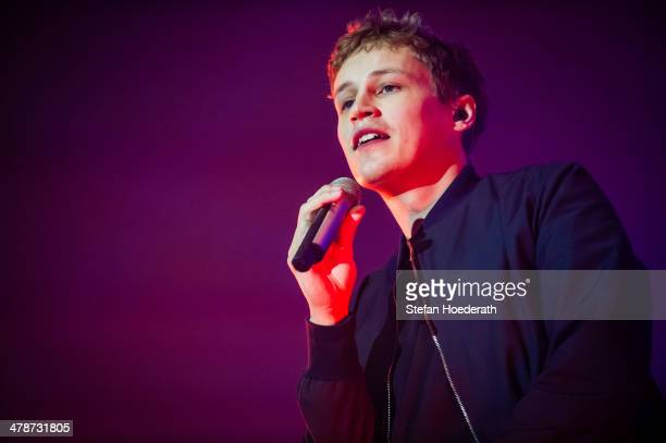 German singer Tim Bendzko performs live during a concert at MaxSchmeling Hall on March 14 2014 in Berlin Germany