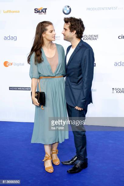 German singer Yvonne Catterfeld and her husband German actor Oliver Wnuk attend the summer party 2017 of the German Producers Alliance on July 12...