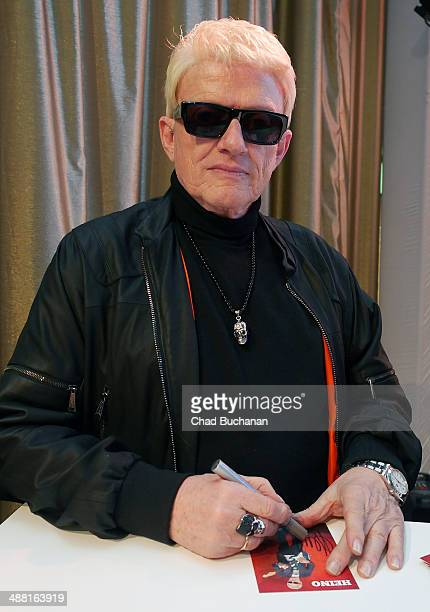 German singing legend Heino meets fans and signs autographs at the Alexa Shopping center on May 4 2014 in Berlin Germany