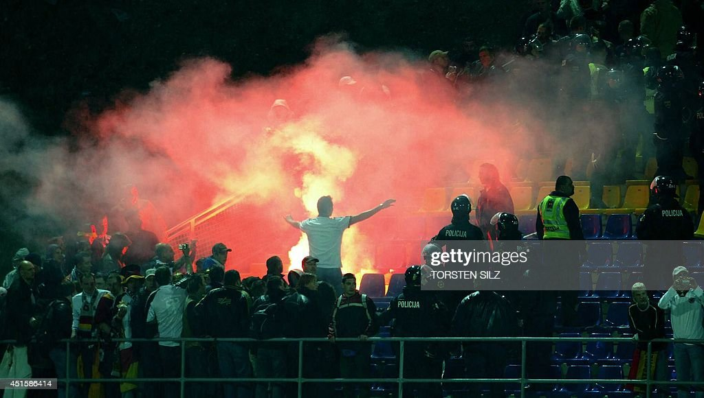 German soccer fans light fireworks during the friendly football match of Slovenia against Germany 26 March 2005 at the Petrol Arena stadium in Celje...