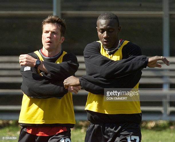 German soccer star Lothar Matthaus does some stretching with teammate Adolfo Valencia of Colombia during practice at Kean University in Elizabeth NJ...