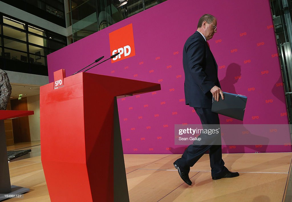 German Social Democrat (SPD) and candidate for Chancellor <a gi-track='captionPersonalityLinkClicked' href=/galleries/search?phrase=Peer+Steinbrueck&family=editorial&specificpeople=209110 ng-click='$event.stopPropagation()'>Peer Steinbrueck</a> departs after speaking to the media to announce a full disclosure of his supplementary income in recent years, mostly from paid speeches he gave, on October 30, 2012 in Berlin, Germany. Steinbrueck will run for Chancellor in 2013 elections, and has recently born heavy criticism for not detailing his supplementary income, which has totaled approximately EUR 1.25 million in the last three years.