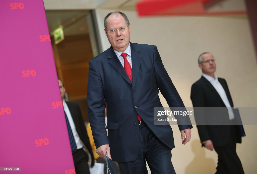 German Social Democrat (SPD) and candidate for Chancellor <a gi-track='captionPersonalityLinkClicked' href=/galleries/search?phrase=Peer+Steinbrueck&family=editorial&specificpeople=209110 ng-click='$event.stopPropagation()'>Peer Steinbrueck</a> arrives to speak to the media to announce a full disclosure of his supplementary income in recent years, mostly from paid speeches he gave, on October 30, 2012 in Berlin, Germany. Steinbrueck will run for Chancellor in 2013 elections, and has recently born heavy criticism for not detailing his supplementary income, which has totaled approximately EUR 1.25 million in the last three years.