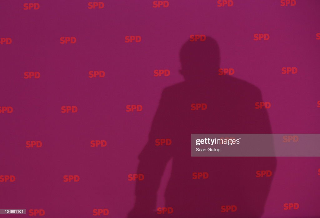 German Social Democrat (SPD) and candidate for Chancellor Peer Steinbrueck casts a shadow as he speaks to the media to announce a full disclosure of his supplementary income in recent years, mostly from paid speeches he gave, on October 30, 2012 in Berlin, Germany. Steinbrueck will run for Chancellor in 2013 elections, and has recently born heavy criticism for not detailing his supplementary income, which has totaled approximately EUR 1.25 million in the last three years.
