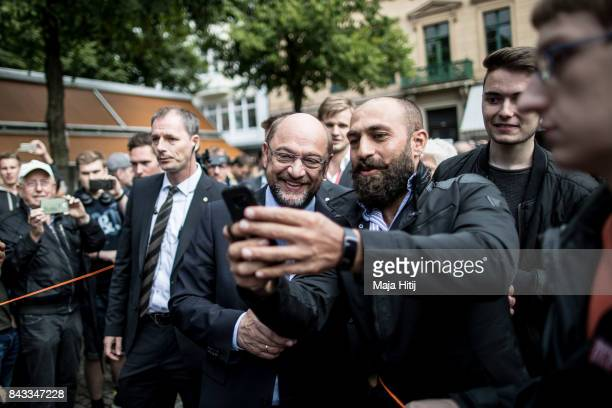 German Social Democrat and chancellor candidate Martin Schulz greets supporters at an election campaign stop on September 6 2017 in Wuppertal Germany...