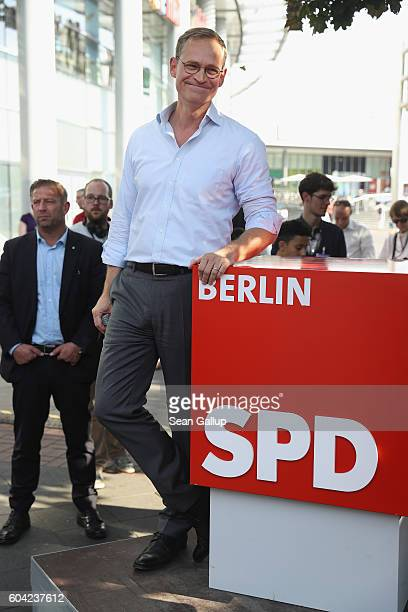 German Social Democrat and current Berlin Mayor Michael Mueller waits to speak as he campaigns in Berlin state elections outside the Gesundbrunnen...