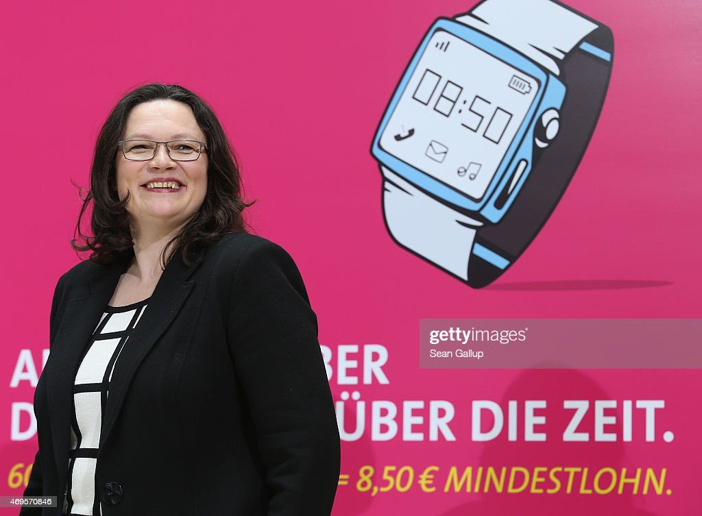 German Social Democrat (SPD) and Minister of Work and Social Issues <a gi-track='captionPersonalityLinkClicked' href=/galleries/search?phrase=Andrea+Nahles&family=editorial&specificpeople=822618 ng-click='$event.stopPropagation()'>Andrea Nahles</a> speaks to the media in front of posters promoting Germany's minimum wage at SPD headquarters on April 13, 2015 in Berlin, Germany. Germany introduced a minimum wage of EUR 8.50 an hour on January 1 and today marks its first 100 days.