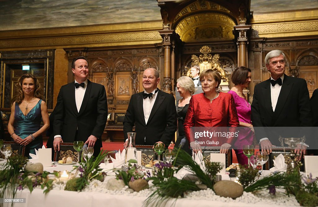 German Social Democrat (SPD) Carola Veit, British Prime Minister <a gi-track='captionPersonalityLinkClicked' href=/galleries/search?phrase=David+Cameron+-+Politician&family=editorial&specificpeople=227076 ng-click='$event.stopPropagation()'>David Cameron</a>, Hamburg Mayor <a gi-track='captionPersonalityLinkClicked' href=/galleries/search?phrase=Olaf+Scholz&family=editorial&specificpeople=2162609 ng-click='$event.stopPropagation()'>Olaf Scholz</a>, German Chancellor <a gi-track='captionPersonalityLinkClicked' href=/galleries/search?phrase=Angela+Merkel&family=editorial&specificpeople=202161 ng-click='$event.stopPropagation()'>Angela Merkel</a> and <a gi-track='captionPersonalityLinkClicked' href=/galleries/search?phrase=Michael+Otto&family=editorial&specificpeople=549344 ng-click='$event.stopPropagation()'>Michael Otto</a> attend the annual Matthiae-Mahl dinner at Hamburg City Hall on February 12, 2016 in Hamburg, Germany. The two leaders are there on the invitation of Hamburg Mayor <a gi-track='captionPersonalityLinkClicked' href=/galleries/search?phrase=Olaf+Scholz&family=editorial&specificpeople=2162609 ng-click='$event.stopPropagation()'>Olaf Scholz</a>, who reportedly saw the dinner as a gesture to show Germany's hope that Great Britain will remain in the European Union. The Matthiae-Mahl is a Hamburg tradition dating back to 1356 and began as a fest to welcome the spring season and also to honor a foreign official.
