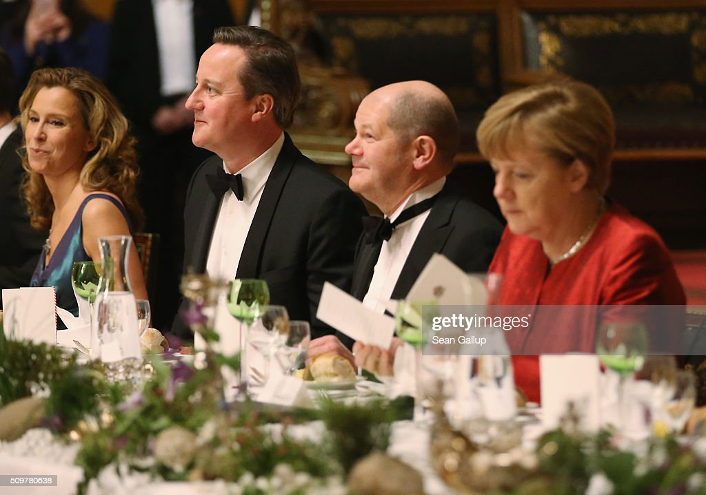 German Social Democrat (SPD) Carola Veit, British Prime Minister <a gi-track='captionPersonalityLinkClicked' href=/galleries/search?phrase=David+Cameron+-+Politician&family=editorial&specificpeople=227076 ng-click='$event.stopPropagation()'>David Cameron</a>, Hamburg Mayor <a gi-track='captionPersonalityLinkClicked' href=/galleries/search?phrase=Olaf+Scholz&family=editorial&specificpeople=2162609 ng-click='$event.stopPropagation()'>Olaf Scholz</a> and German Chancellor <a gi-track='captionPersonalityLinkClicked' href=/galleries/search?phrase=Angela+Merkel&family=editorial&specificpeople=202161 ng-click='$event.stopPropagation()'>Angela Merkel</a> attend the annual Matthiae-Mahl dinner at Hamburg City Hall on February 12, 2016 in Hamburg, Germany. The two leaders are there on the invitation of Hamburg Mayor <a gi-track='captionPersonalityLinkClicked' href=/galleries/search?phrase=Olaf+Scholz&family=editorial&specificpeople=2162609 ng-click='$event.stopPropagation()'>Olaf Scholz</a>, who reportedly saw the dinner as a gesture to show Germany's hope that Great Britain will remain in the European Union. The Matthiae-Mahl is a Hamburg tradition dating back to 1356 and began as a fest to welcome the spring season and also to honor a foreign official.
