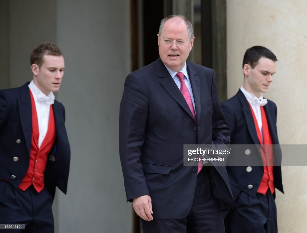 German Social Democrat (SPD) leader Peer Steinbrueck leaves the Elysee presidential palace after a meeting with France's president on April 5, 2013 in Paris.