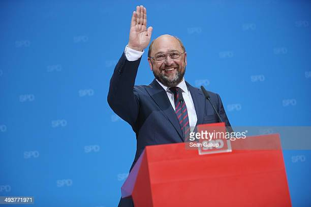 German Social Democrat Martin Schulz who has been leading in pools to become the next president of the European Commission gestures after the...