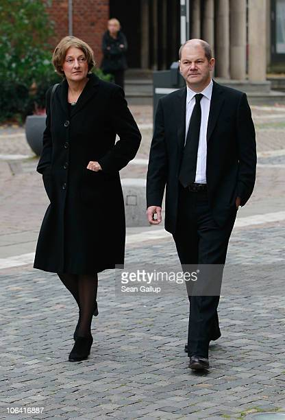German Social Democrat Olaf Scholz and his wife Britta Ernst arrive for the memorial service for Loki Schmidt wife of former German Chancellor Helmut...
