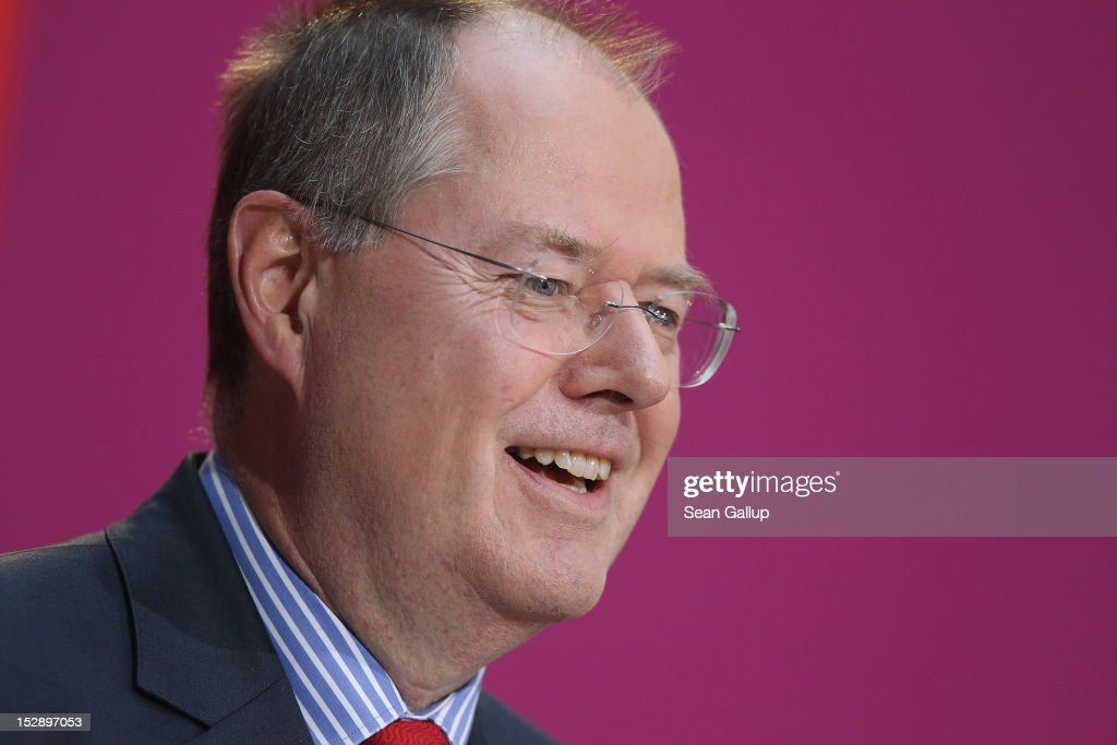 German Social Democrat (SPD) <a gi-track='captionPersonalityLinkClicked' href=/galleries/search?phrase=Peer+Steinbrueck&family=editorial&specificpeople=209110 ng-click='$event.stopPropagation()'>Peer Steinbrueck</a> smiles as he gives a statement to the press on September 28, 2012 in Berlin, Germany. The SPD confirmed <a gi-track='captionPersonalityLinkClicked' href=/galleries/search?phrase=Peer+Steinbrueck&family=editorial&specificpeople=209110 ng-click='$event.stopPropagation()'>Peer Steinbrueck</a> as its candidate for chancellor to run against Angela Merkel in 2013 general elections. Steinbrueck, formerly a member of Merkel's cabinet as finance minister, was widely respected for his dealing with the financial crisis in 2008 after the bankruptcy of Lehmann Brothers.
