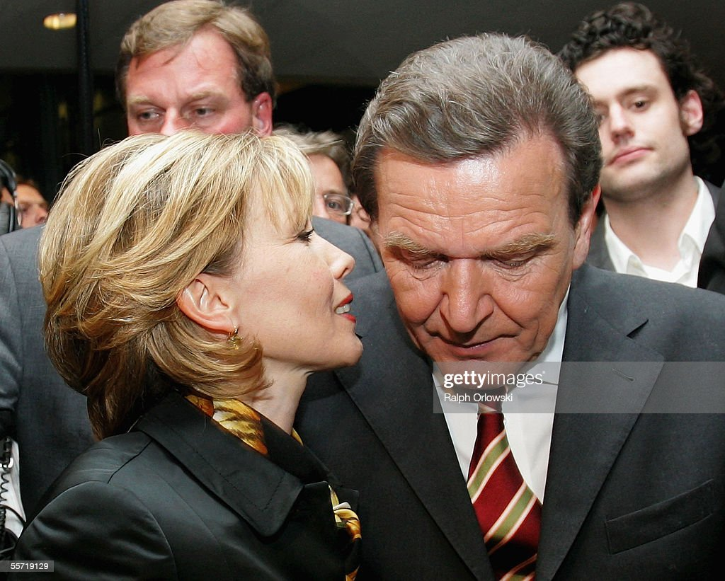 German Social Democrat (SPD) top candidate Chancellor Gerhard Schroeder and his wife Doris Schroeder-Koepf (L) make their way through supporters after the first election results September 18, 2005 in Berlin, Germany. Chancellor Gerhard Schroeder and his conservative challenger Angela Merkel each staked competing claims to lead Europe's biggest economy after a cliffhanger general election that left Germany in political limbo. Picture taken September 18.