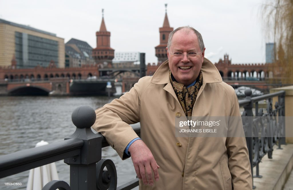German Social Democratic Party (SPD) chancellor candidate Peer Steinbrueck poses in front of the Oberbaum bridge in Berlin on April 3, 2013. Steinbrueck visited various firms including Universal Music Group International as part of his regional tour in this general election year.