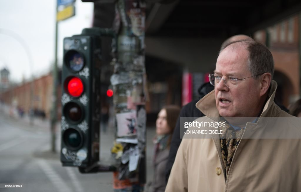 German Social Democratic Party (SPD) chancellor candidate Peer Steinbrueck poses in Berlin on April 3, 2013. Steinbrueck visited various firms including Universal Music Group International as part of his regional tour in this general election year.