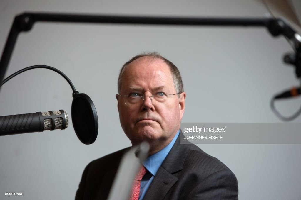 German Social Democratic Party (SPD) chancellor candidate Peer Steinbrueck is interviewed in a radio station in Berlin on April 3, 2013. Steinbrueck visited various firms including Universal Music Group International as part of his regional tour in this general election year.