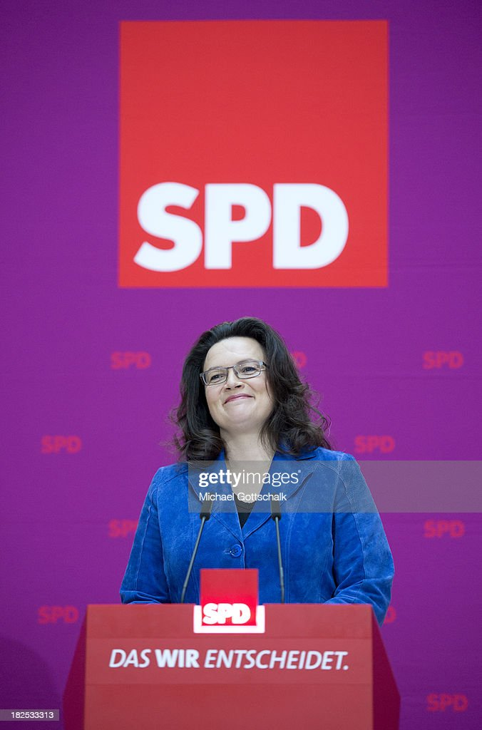 German Social Democratic Party (SPD) General Secretary <a gi-track='captionPersonalityLinkClicked' href=/galleries/search?phrase=Andrea+Nahles&family=editorial&specificpeople=822618 ng-click='$event.stopPropagation()'>Andrea Nahles</a> addresses reporters in front of the logo of SPD after a meeting of the SPD Governing Board at SPD headquarters on September 30, 2013 in Berlin, Germany.