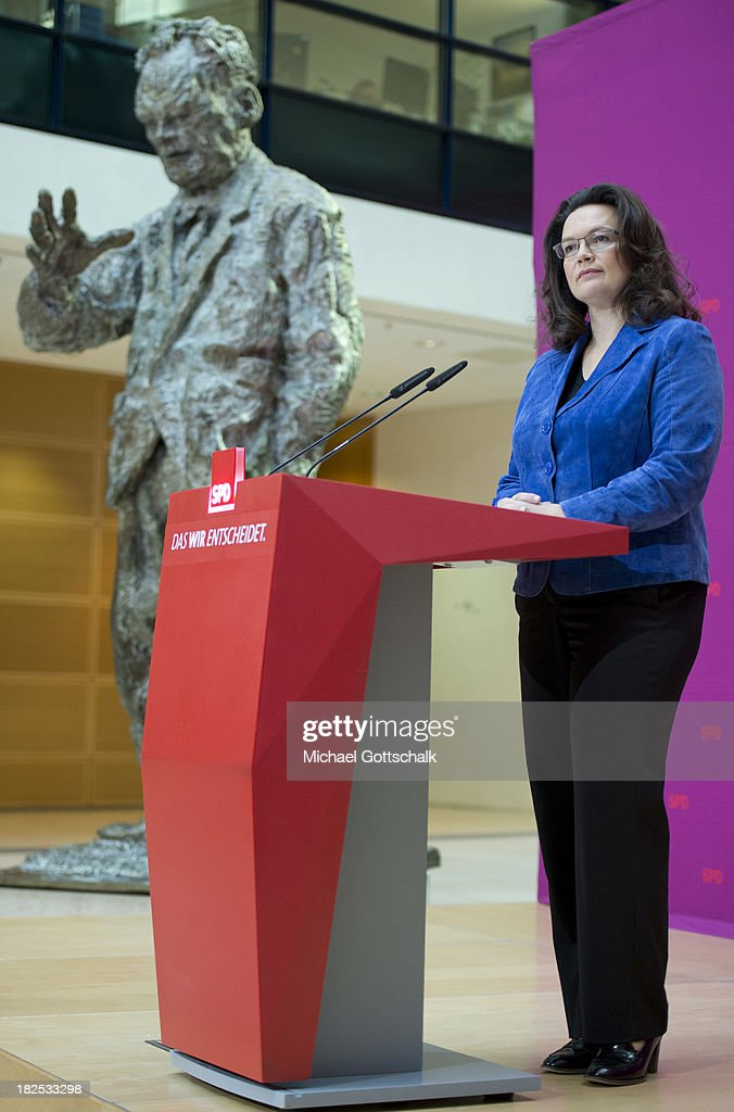 German Social Democratic Party (SPD) General Secretary <a gi-track='captionPersonalityLinkClicked' href=/galleries/search?phrase=Andrea+Nahles&family=editorial&specificpeople=822618 ng-click='$event.stopPropagation()'>Andrea Nahles</a> addresses reporters next to a statue of former chancellor Willy Brandt after a meeting of the SPD Governing Board at SPD headquarters on September 30, 2013 in Berlin, Germany.