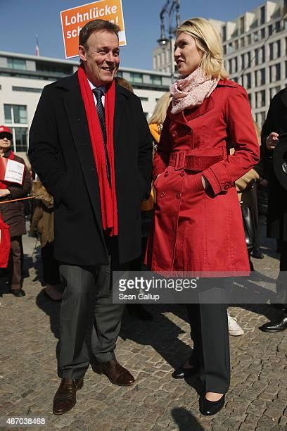 German Social Democrats Bundestag faction leader Thomas Oppermann chats with Family Minister and SPD member Manuela Schwesig at a rally for equal pay...