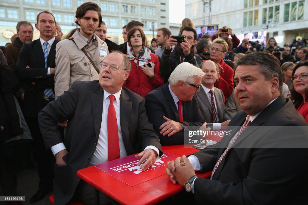 German Social Democrats (SPD) chancellor candidate <a gi-track='captionPersonalityLinkClicked' href=/galleries/search?phrase=Peer+Steinbrueck&family=editorial&specificpeople=209110 ng-click='$event.stopPropagation()'>Peer Steinbrueck</a> (L), along with SPD Chairman <a gi-track='captionPersonalityLinkClicked' href=/galleries/search?phrase=Sigmar+Gabriel&family=editorial&specificpeople=543927 ng-click='$event.stopPropagation()'>Sigmar Gabriel</a> (R) and SPD Bundestag faction head <a gi-track='captionPersonalityLinkClicked' href=/galleries/search?phrase=Frank-Walter+Steinmeier&family=editorial&specificpeople=603500 ng-click='$event.stopPropagation()'>Frank-Walter Steinmeier</a>, attends an SPD election rally on September 16, 2013 in Berlin, Germany. Germany faces federal elections on September 22 and so far the SPD has less than half the support in polls compared to the governing German Christian Democrats (CDU), though the election outcome could force the two parties to form a coalition.
