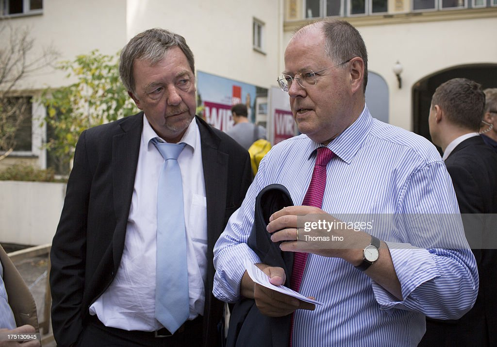 German Social Democrats (SPD) chancellor candidate <a gi-track='captionPersonalityLinkClicked' href=/galleries/search?phrase=Peer+Steinbrueck&family=editorial&specificpeople=209110 ng-click='$event.stopPropagation()'>Peer Steinbrueck</a> and his speker Rolf Kleine after a presentation of the SPD election campaign to the media on July 30, 2013 in Berlin, Germany.