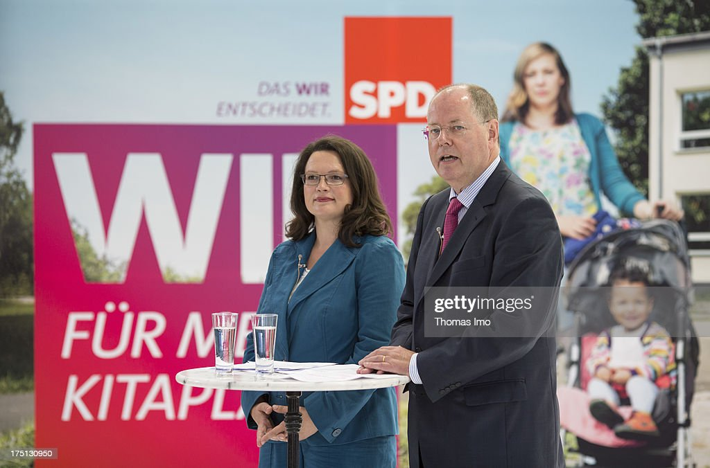 German Social Democrats (SPD) chancellor candidate <a gi-track='captionPersonalityLinkClicked' href=/galleries/search?phrase=Peer+Steinbrueck&family=editorial&specificpeople=209110 ng-click='$event.stopPropagation()'>Peer Steinbrueck</a> and SPD General Secretary <a gi-track='captionPersonalityLinkClicked' href=/galleries/search?phrase=Andrea+Nahles&family=editorial&specificpeople=822618 ng-click='$event.stopPropagation()'>Andrea Nahles</a> in front of election campaign posters while a presentation of the SPD election campaign to the media on July 30, 2013 in Berlin, Germany.