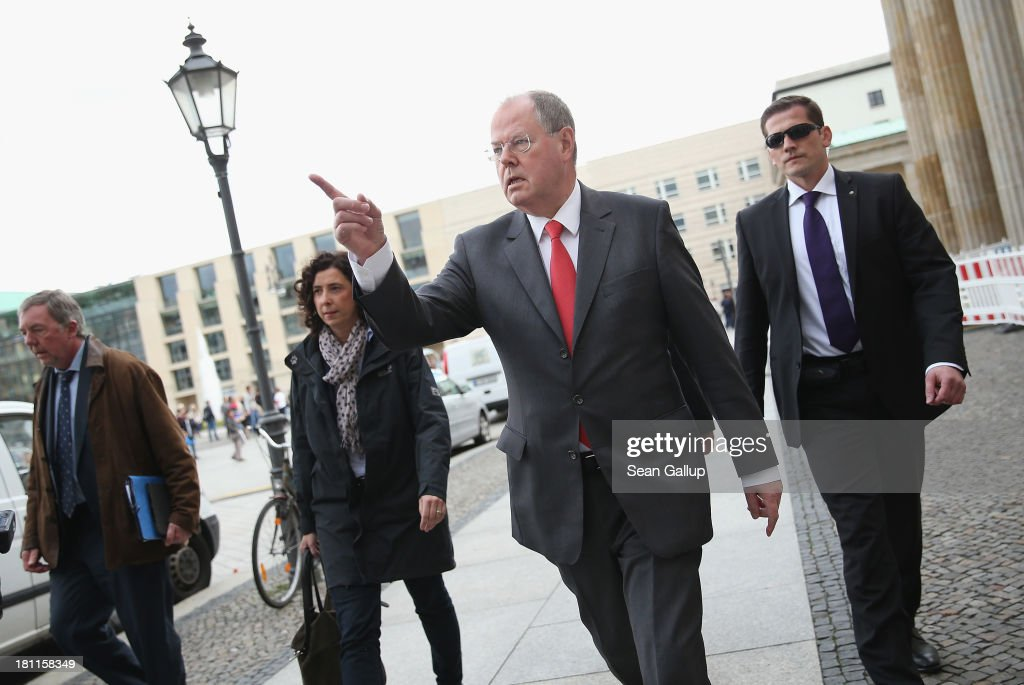 German Social Democrats (SPD) chancellor candidate Peer Steinbrueck arrives shortly before attending an SPD election rally to meet with writers who had signed an open letter to Chancellor Angela Merkel over the NSA surveillance scandal on September 16, 2013 in Berlin, Germany. Germany faces federal elections on September 22 and so far the SPD has less than half the support in polls compared to the governing German Christian Democrats (CDU), though the election outcome could force the two parties to form a coalition.