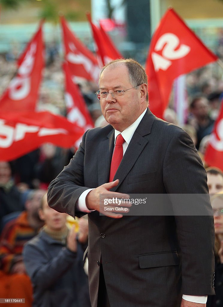 German Social Democrats chancellor candidate Peer Steinbrueck arrives to speak to supporters at an SPD election rally on September 16 2013 in Berlin...
