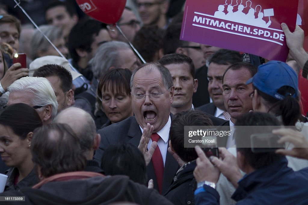 German Social Democrats chancellor candidate Peer Steinbrueck arrives to speak to visitors at an SPD election rally on September 16 2013 in Berlin...