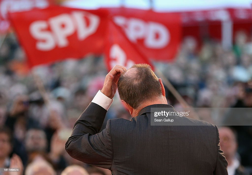 German Social Democrats (SPD) chancellor candidate <a gi-track='captionPersonalityLinkClicked' href=/galleries/search?phrase=Peer+Steinbrueck&family=editorial&specificpeople=209110 ng-click='$event.stopPropagation()'>Peer Steinbrueck</a> scratches his head while speaking to visitors at an SPD election rally on September 16, 2013 in Berlin, Germany. Germany faces federal elections on September 22 and so far the SPD has less than half the support in polls compared to the governing German Christian Democrats (CDU), though the election outcome could force the two parties to form a coalition.