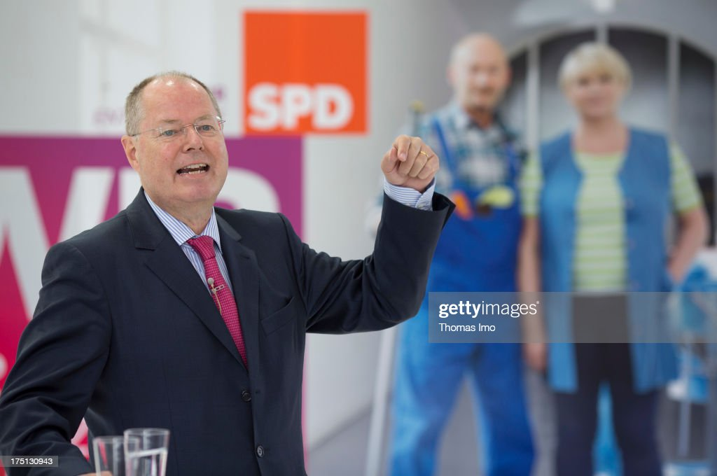 German Social Democrats (SPD) chancellor candidate <a gi-track='captionPersonalityLinkClicked' href=/galleries/search?phrase=Peer+Steinbrueck&family=editorial&specificpeople=209110 ng-click='$event.stopPropagation()'>Peer Steinbrueck</a> in front of election campaign posters while a presentation of the SPD election campaign to the media on July 30, 2013 in Berlin, Germany.