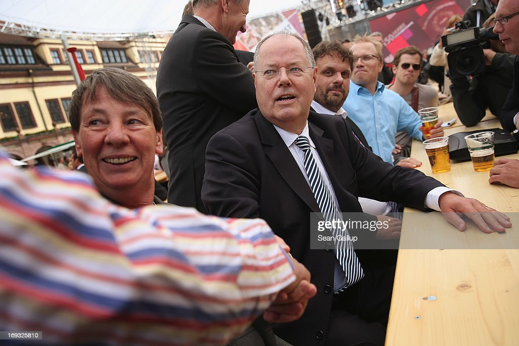 German Social Democrats (SPD) chancellor candidate <a gi-track='captionPersonalityLinkClicked' href=/galleries/search?phrase=Peer+Steinbrueck&family=editorial&specificpeople=209110 ng-click='$event.stopPropagation()'>Peer Steinbrueck</a> shakes hands with a supporter during the 150th anniversary celebration of the SPD on May 23, 2013 in Leipzig, Germany. The SPD, Germany's main left-wing party, traces its history to the founding of the 'Allgemeine Deutsche Arbeiterverein' (General German Workers' Association) in Leipzig in May of 1863. Germany faces federal elections in September.