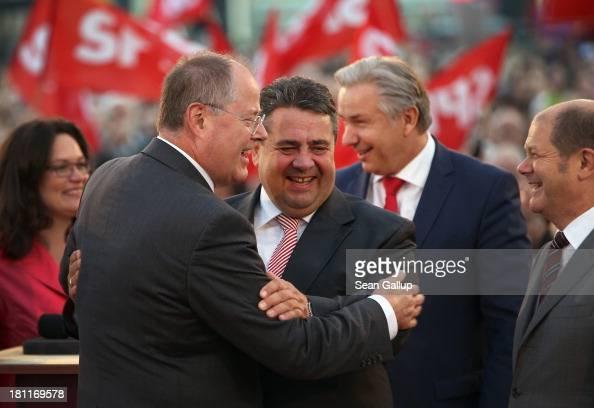 German Social Democrats chancellor candidate Peer Steinbrueck embraces SPD Chairman Sigmar Gabriel as Berlin mayor Klaus Wowereit and Hamburg mayor...