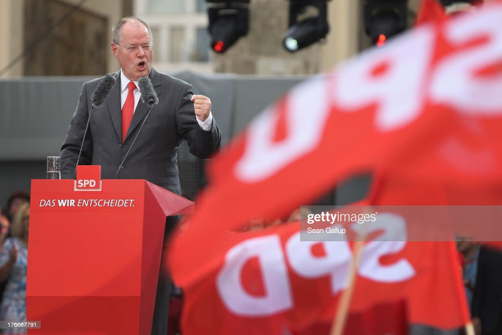 German Social Democrats (SPD) chancellor candidate <a gi-track='captionPersonalityLinkClicked' href=/galleries/search?phrase=Peer+Steinbrueck&family=editorial&specificpeople=209110 ng-click='$event.stopPropagation()'>Peer Steinbrueck</a> speaks to supporters at the 'Deutschland Fest' marking the 150th anniversary of the SPD on August 17, 2013 in Berlin, Germany. Steinbrueck is trailing incumbent Chancellor Angela Merkel and the German Christian Democrats (CDU) significantly ahead of federal elections scheduled for September 22.