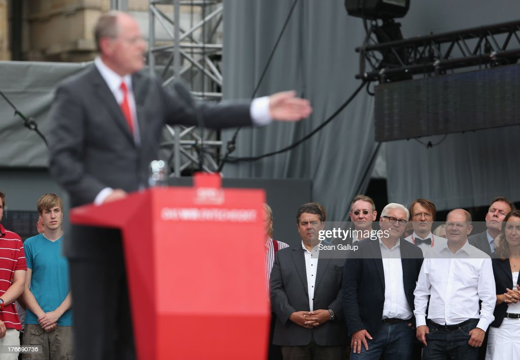 German Social Democrats (SPD) chancellor candidate <a gi-track='captionPersonalityLinkClicked' href=/galleries/search?phrase=Peer+Steinbrueck&family=editorial&specificpeople=209110 ng-click='$event.stopPropagation()'>Peer Steinbrueck</a> speaks to supporters while leading SPD party members, including (from L to R) SPD Chairman <a gi-track='captionPersonalityLinkClicked' href=/galleries/search?phrase=Sigmar+Gabriel&family=editorial&specificpeople=543927 ng-click='$event.stopPropagation()'>Sigmar Gabriel</a>, SPD Bundestag faction leader <a gi-track='captionPersonalityLinkClicked' href=/galleries/search?phrase=Frank-Walter+Steinmeier&family=editorial&specificpeople=603500 ng-click='$event.stopPropagation()'>Frank-Walter Steinmeier</a> and Hamburg mayor <a gi-track='captionPersonalityLinkClicked' href=/galleries/search?phrase=Olaf+Scholz&family=editorial&specificpeople=2162609 ng-click='$event.stopPropagation()'>Olaf Scholz</a> at the 'Deutschland Fest' marking the 150th anniversary of the SPD on August 17, 2013 in Berlin, Germany. Steinbrueck is trailing incumbent Chancellor Angela Merkel and the German Christian Democrats (CDU) significantly ahead of federal elections scheduled for September 22.