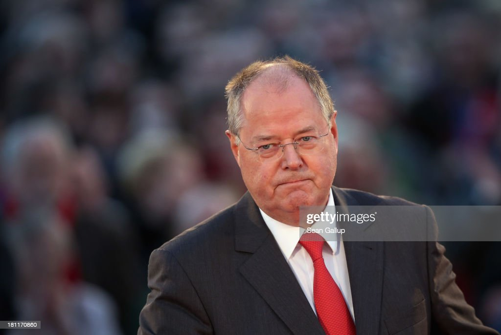 German Social Democrats (SPD) chancellor candidate <a gi-track='captionPersonalityLinkClicked' href=/galleries/search?phrase=Peer+Steinbrueck&family=editorial&specificpeople=209110 ng-click='$event.stopPropagation()'>Peer Steinbrueck</a> speaks to visitors at an SPD election rally on September 16, 2013 in Berlin, Germany. Germany faces federal elections on September 22 and so far the SPD has less than half the support in polls compared to the governing German Christian Democrats (CDU), though the election outcome could force the two parties to form a coalition.