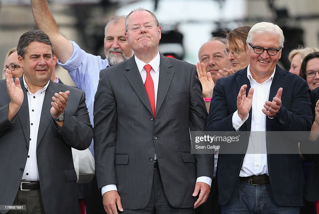 German Social Democrats (SPD) chancellor candidate <a gi-track='captionPersonalityLinkClicked' href=/galleries/search?phrase=Peer+Steinbrueck&family=editorial&specificpeople=209110 ng-click='$event.stopPropagation()'>Peer Steinbrueck</a> (C) stands on stage with SPD Chairman <a gi-track='captionPersonalityLinkClicked' href=/galleries/search?phrase=Sigmar+Gabriel&family=editorial&specificpeople=543927 ng-click='$event.stopPropagation()'>Sigmar Gabriel</a> (L) and SPD Bundestag faction leader <a gi-track='captionPersonalityLinkClicked' href=/galleries/search?phrase=Frank-Walter+Steinmeier&family=editorial&specificpeople=603500 ng-click='$event.stopPropagation()'>Frank-Walter Steinmeier</a> after speaking at the 'Deutschland Fest' marking the 150th anniversary of the SPD on August 17, 2013 in Berlin, Germany. Steinbrueck is trailing incumbent Chancellor Angela Merkel and the German Christian Democrats (CDU) significantly ahead of federal elections scheduled for September 22.