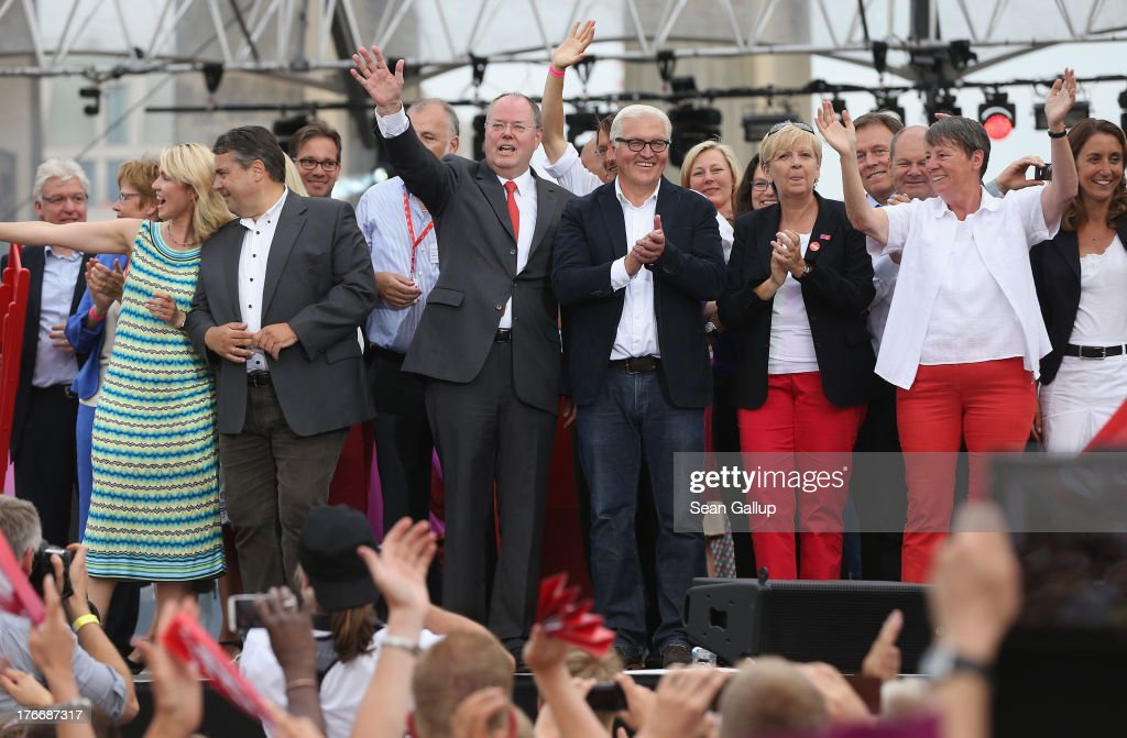 German Social Democrats (SPD) chancellor candidate <a gi-track='captionPersonalityLinkClicked' href=/galleries/search?phrase=Peer+Steinbrueck&family=editorial&specificpeople=209110 ng-click='$event.stopPropagation()'>Peer Steinbrueck</a> (C) waves to supporters while standing on stage with other leading party members, including Chairman <a gi-track='captionPersonalityLinkClicked' href=/galleries/search?phrase=Sigmar+Gabriel&family=editorial&specificpeople=543927 ng-click='$event.stopPropagation()'>Sigmar Gabriel</a>, <a gi-track='captionPersonalityLinkClicked' href=/galleries/search?phrase=Frank-Walter+Steinmeier&family=editorial&specificpeople=603500 ng-click='$event.stopPropagation()'>Frank-Walter Steinmeier</a> and <a gi-track='captionPersonalityLinkClicked' href=/galleries/search?phrase=Hannelore+Kraft&family=editorial&specificpeople=4643983 ng-click='$event.stopPropagation()'>Hannelore Kraft</a>, after speaking at the 'Deutschland Fest' marking the 150th anniversary of the SPD on August 17, 2013 in Berlin, Germany. Stenbrueck is trailing incumbent Chancellor Angela Merkel and the German Christian Democrats (CDU) significantly ahead of federal elections scheuled for September 22.