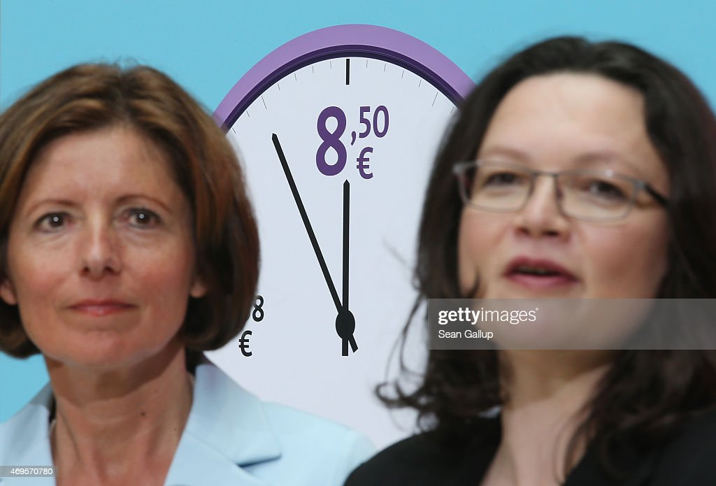 German Social Democrats (SPD) Malu Dreyer (L), Governor of Rhineland-Palatinate, and <a gi-track='captionPersonalityLinkClicked' href=/galleries/search?phrase=Andrea+Nahles&family=editorial&specificpeople=822618 ng-click='$event.stopPropagation()'>Andrea Nahles</a>, Minister of Work and Social Issues, speak to the emdia in front of posters promoting Germany's minimum wage at SPD headquarters on April 13, 2015 in Berlin, Germany. Germany, through legislation sponsored in large part by the SPD, introduced a minimum wage of EUR 8.50 an hour on January 1 and today marks its first 100 days.