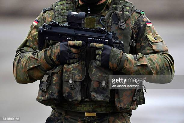 German soldier holds a machine gun MP7 during the 'Land Operations' military exercises during a media day at the Bundeswehr training grounds on...