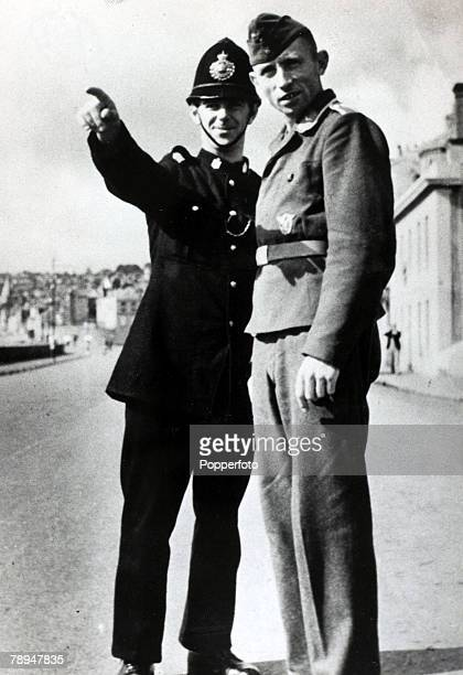 September 1940 The Occupation of the Channel Islands A German soldier given directions by a British policeman on Guernsey Channel Islands formerly...