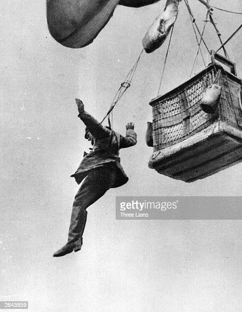 A German soldier jumps from an observation balloon after it had been destroyed by enemy action Note the primitive parachute