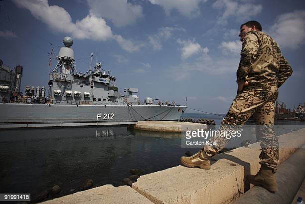 A german soldier walks in front of the frigate Karlsruhe in the Port of Djibouti on December 15 2008 in Djibouti The warship F212 of the German Navy...