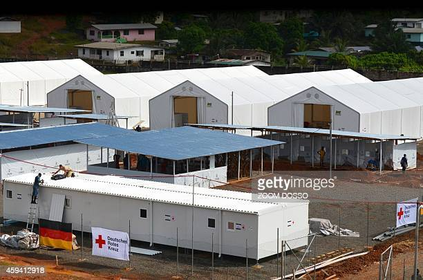 German soldiers along side German Red Cross workers construct an Ebola treatment center on November 21 in the Liberian capital Monrovia The German...