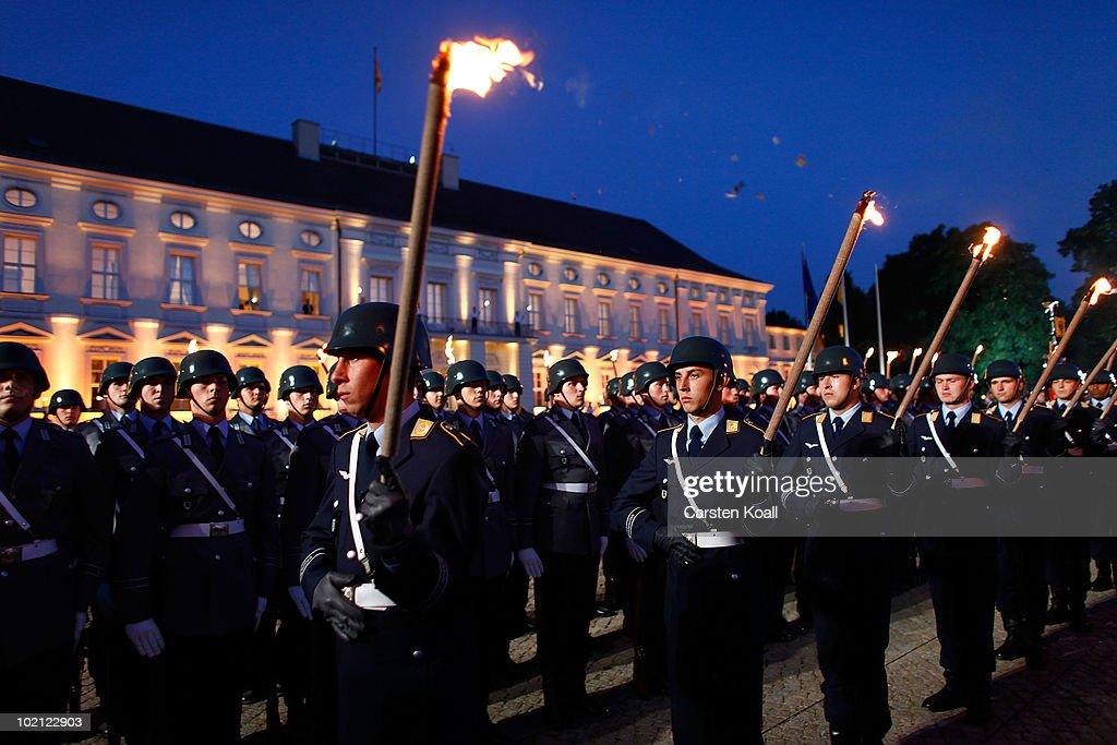 German soldiers attend the farewell ceremony as the outgoing German President Host Koehler is honoured by a military tattoo at the at Bellevue Palace on June 15, 2010 in Berlin, Germany. German President Horst Koehler resigned on May 31 after being criticized for remarks in which he appeared to link military deployments abroad with the country's economic interests.