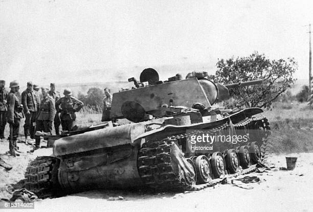 German soldiers examine a 52ton Soviet tank that has been disabled by German sharpshooters