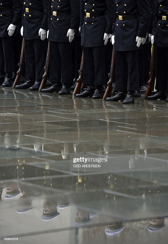 German soldiers of an honor guard wait for the start of a ceremony to welcome the Spanish Prime Minister at the Chancellery in Berlin on February 4, 2013. Mariano Rajoy and a delegation of ministers are expected for talks in the German capital.
