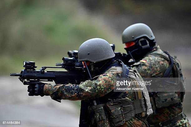 German soldiers of the Quick Reaction Force participate in the 'Land Operations' military exercises during a media day at the Bundeswehr training...